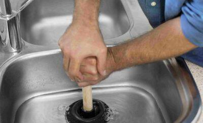 How to Clear Kitchen Sink Clog Using the Plunger