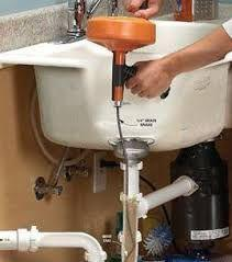 Unclog the sink using the auger